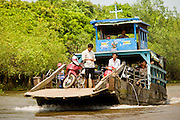12 MARCH 2006 - CAI BE, TIEN GIANG, VIETNAM: A passenger ferry hauls people to a village near Cai Be in the Mekong River delta. The Mekong is the lifeblood of southern Vietnam. It is the country's rice bowl and has enabled Vietnam to become the second leading rice exporting country in the world (after Thailand). The Mekong delta also carries commercial and passenger traffic throughout the region.  PHOTO BY JACK KURTZ