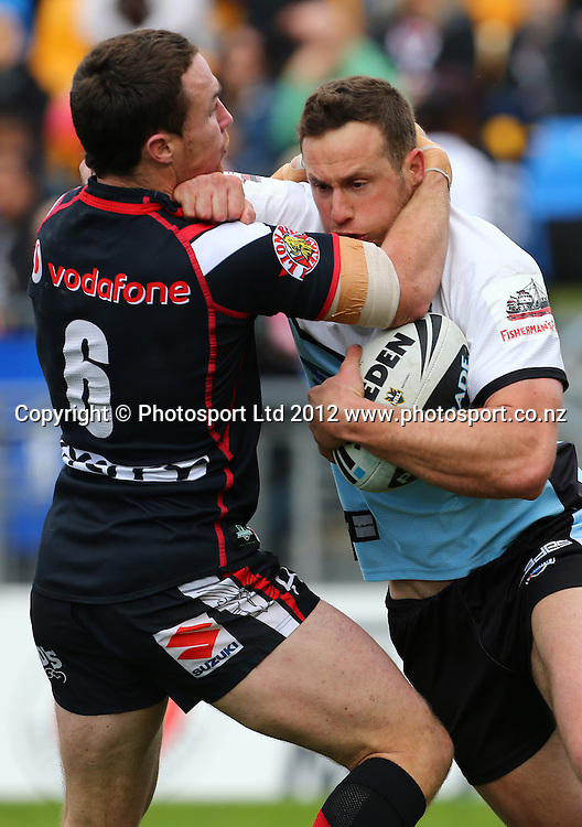 Colin Best of the Sharks is tackled by James Maloney of the Warriors during the NRL game, Vodafone Warriors v Cronulla Sharks, Mt Smart Stadium, Auckland, Sunday 5 August  2012. Photo: Simon Watts /photosport.co.nz