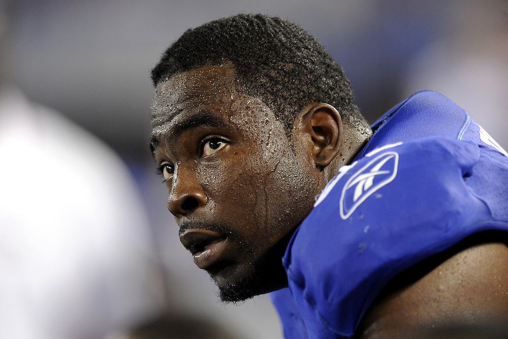 EAST RUTHERFORD, NJ - AUGUST 29: Justin Tuck #91 of the New York Giants looks on against the New York Jets during a preseason game at Giants Stadium on August 29, 2009 in East Rutherford, New Jersey. The New York Jets beat the New York Giants 27-25. (Photo by Rob Tringali) *** Local Caption *** Justin Tuck