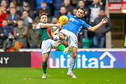 Lewis Stevenson (#16) of Hibernian FC and Tony Watt (#32) of St Johnstone FC compete for the ball during the Ladbrokes Scottish Premiership match between Hibernian and St Johnstone at Easter Road, Edinburgh, Scotland on 3 November 2018.