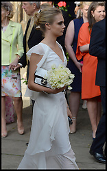 Cara Delevingne after the service at the wedding of her sister  Poppy Delevingne to James Cook at St.Paul's Church in Knightsbridge, London,  Friday, 16th May 2014. Picture by Andrew Parsons / i-Images