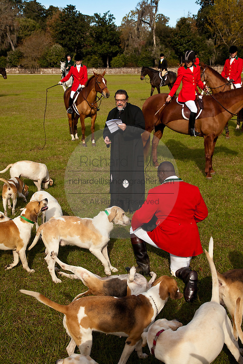Rev. Dick Reed of St. James Church blesses the foxhounds and fox hunters during the start of the fox hunting season at Middleton Place plantation in Charleston, South Carolina. The hunt is a drag hunt where a scented cloth is used instead of live fox.