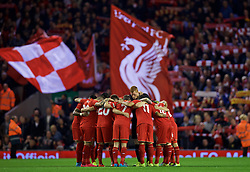 LIVERPOOL, ENGLAND - Wednesday, September 23, 2015: Liverpool players form a team huddle before the Football League Cup 3rd Round match against Carlisle United at Anfield. (Pic by David Rawcliffe/Propaganda)