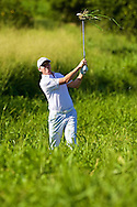 January 11 2015:  Jimmy Walker hits out of trouble on fourteen trying to hold on to a two stroke lead during the Third Round of the Hyundai Tournament of Champions at Kapalua Plantation Course on Maui, HI.