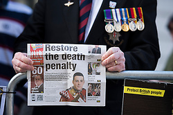 "© London News Pictures. 26/02/2014. London, UK.  A war Veterans holding a page from a newspaper with the words ""Restore the death penalty"" showing outside the Old Bailey in London where Michael Adebolajo and Michael Adebowale are due to be sentenced for the murder of Fusilier Lee Rigby who was attacked near Woolwich Barracks in south-east London on May 22, 2013. Photo credit: Ben Cawthra/LNP"