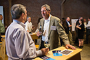 Brian Carolan of the Silicon Valley Business Journal (right) talks with Farley Gouner of the Business Team during the Silicon Valley Business Journal's HHaaS Tech Mixer at ZERO1 in San Jose, California, on May 28, 2015. (Stan Olszewski/SOSKIphoto for the Silicon Valley Business Journal)