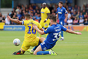 AFC Wimbledon midfielder Callum Reilly (33) battles for possession with Wycombe Wanderers midfielder Matthew (Matt) Bloomfield (10) during the EFL Sky Bet League 1 match between AFC Wimbledon and Wycombe Wanderers at the Cherry Red Records Stadium, Kingston, England on 31 August 2019.