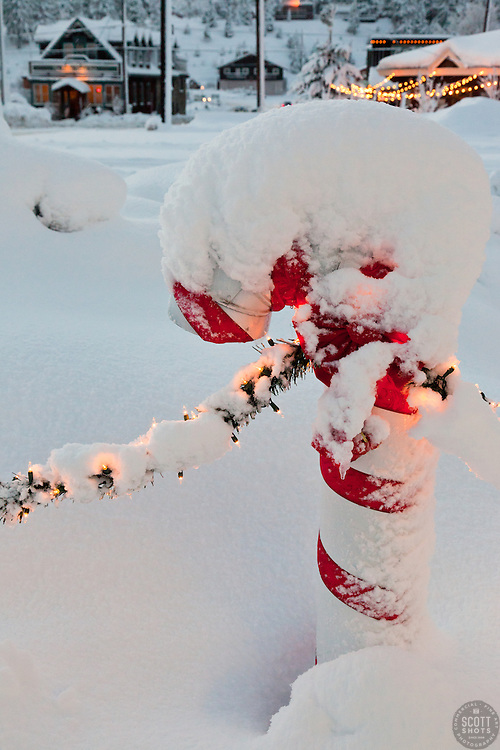 """Snowy Candy Cane in Truckee"" - This snow covered Christmas candy cane was photographed in historic Downtown Truckee, CA."
