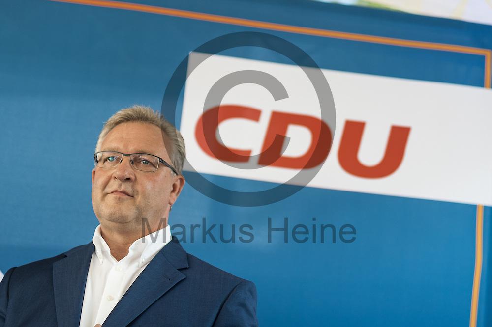 Der Senator f&uuml;r Inneres und Sport Frank Henkel (CDU) steht w&auml;hrend des CDU Sommerfest am 30.06.2016 in Berlin, Deutschland auf der B&uuml;hne. Foto: Markus Heine / heineimaging<br /> <br /> ------------------------------<br /> <br /> Ver&ouml;ffentlichung nur mit Fotografennennung, sowie gegen Honorar und Belegexemplar.<br /> <br /> Bankverbindung:<br /> IBAN: DE65660908000004437497<br /> BIC CODE: GENODE61BBB<br /> Badische Beamten Bank Karlsruhe<br /> <br /> USt-IdNr: DE291853306<br /> <br /> Please note:<br /> All rights reserved! Don't publish without copyright!<br /> <br /> Stand: 06.2016<br /> <br /> ------------------------------w&auml;hrend des Sommerfest der CDU Pankow am 30.06.2016 in Berlin, Deutschland. Foto: Markus Heine / heineimaging<br /> <br /> ------------------------------<br /> <br /> Ver&ouml;ffentlichung nur mit Fotografennennung, sowie gegen Honorar und Belegexemplar.<br /> <br /> Bankverbindung:<br /> IBAN: DE65660908000004437497<br /> BIC CODE: GENODE61BBB<br /> Badische Beamten Bank Karlsruhe<br /> <br /> USt-IdNr: DE291853306<br /> <br /> Please note:<br /> All rights reserved! Don't publish without copyright!<br /> <br /> Stand: 06.2016<br /> <br /> ------------------------------