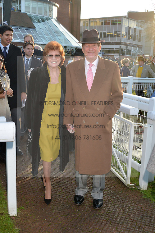 CILLA BLACK and SIR JOHN MADEJSKI at the 2014 Hennessy Gold Cup at Newbury Racecourse, Newbury, Berkshire on 29th November 2014.  The Gold Cup was won by Many Clouds ridden by Leighton Aspell.
