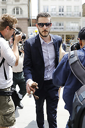 &copy; Licensed to London News Pictures. 10/07/2017. London, UK. Connie Yates and <br /> Chris Gard arrive at The High Court in London on 10 July 2017. The parents of terminally ill Charlie Gard have returned to the High Court in light of new evidence relating to potential treatment for their son's condition. An earlier lengthy legal battle ruled that Charlie could not be taken to the US for experimental treatment. London, UK. Photo credit: Tolga Akmen/LNP