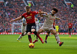 MANCHESTER, ENGLAND - Sunday, February 24, 2019: Manchester United's Luke Shaw (L) and Liverpool's Mohamed Salah during the FA Premier League match between Manchester United FC and Liverpool FC at Old Trafford. (Pic by David Rawcliffe/Propaganda)