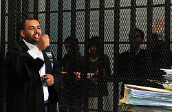 A Yemeni lawyer speaks as suspected al-Qaida militants behind bars attend their first hearing in a state security court in Sanaa, Yemen,  March 4, 2013. Photo by Imago / i-Images...UK ONLY