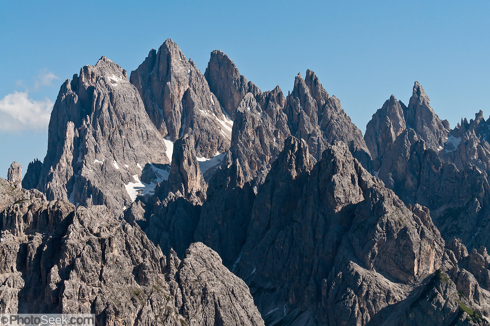 "The peaks of the Cadini Group jut high in the Dolomites range near Cortina d'Ampezzo, Veneto region, Italy, Europe. In the Cadini di Misurina, Cima Grande rises to 2999 meters (9839 feet), between Cima Piccola 2857 m (9373 ft) and Cima Ovest or ""Western Peak"" 2973 m (9754 ft). The Dolomites are part of the Southern Limestone Alps, in northern Italy, Europe. UNESCO honored the Dolomites as a natural World Heritage Site in 2009."