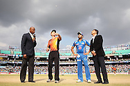Perth Scorchers captain Simon Katich tosses the coin as Mumbai Indians captain Rohit Sharma calls and Match Referee R Mahanama looks on during match 19 of the Karbonn Smart Champions League T20 between the Perth Scorchers and the Mumbai Indians held at the Feroz Shah Kotla Stadium, Delhi on the 2nd October 2013<br /> <br /> <br /> Photo by Shaun Roy-CLT20-SPORTZPICS <br /> <br /> Use of this image is subject to the terms and conditions as outlined by the CLT20. These terms can be found by following this link:<br /> <br /> http://sportzpics.photoshelter.com/image/I0000NmDchxxGVv4