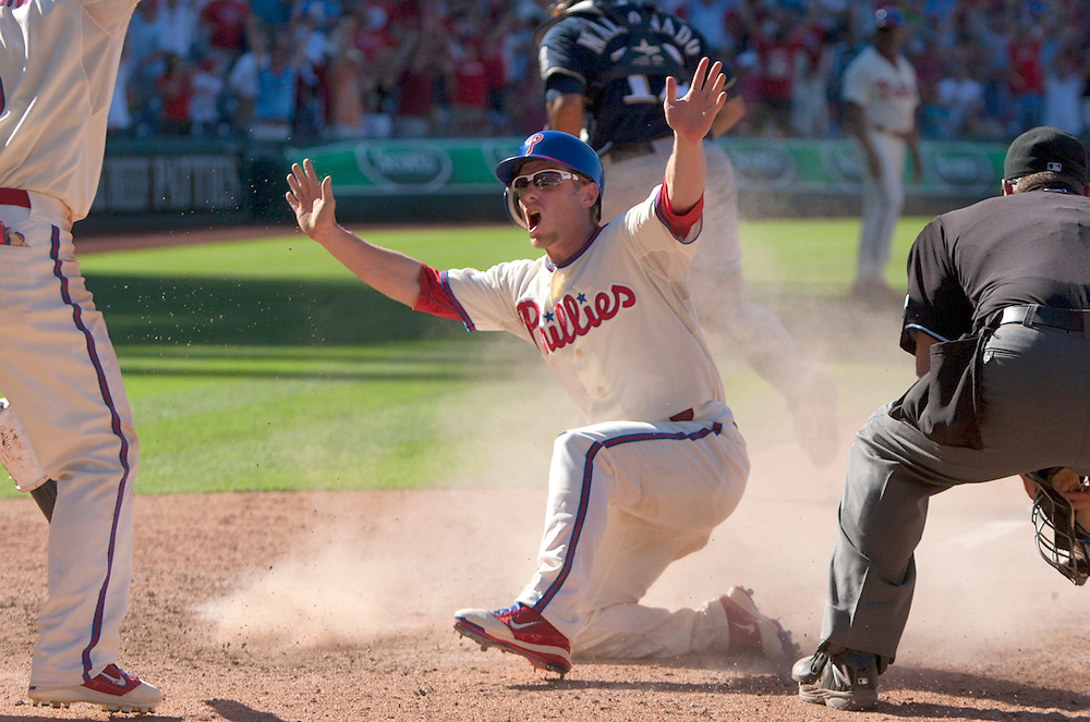 Phils beat Milwaukee 7-6 in extra inning to sweep the series. Here, Mike Fontenot reacts as he scores the winning run off a Jimmy Rollins hit in the 10th. Fontenot was a pinch runner. Shane Victorino  greeted him at the plate. ( ED HILLE  / Staff Photographer )