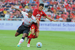 BANGKOK, THAILAND - Sunday, July 28, 2013: Liverpool's Glen Johnson in action against Thailand XI during a preseason friendly match at the Rajamangala National Stadium. (Pic by David Rawcliffe/Propaganda)