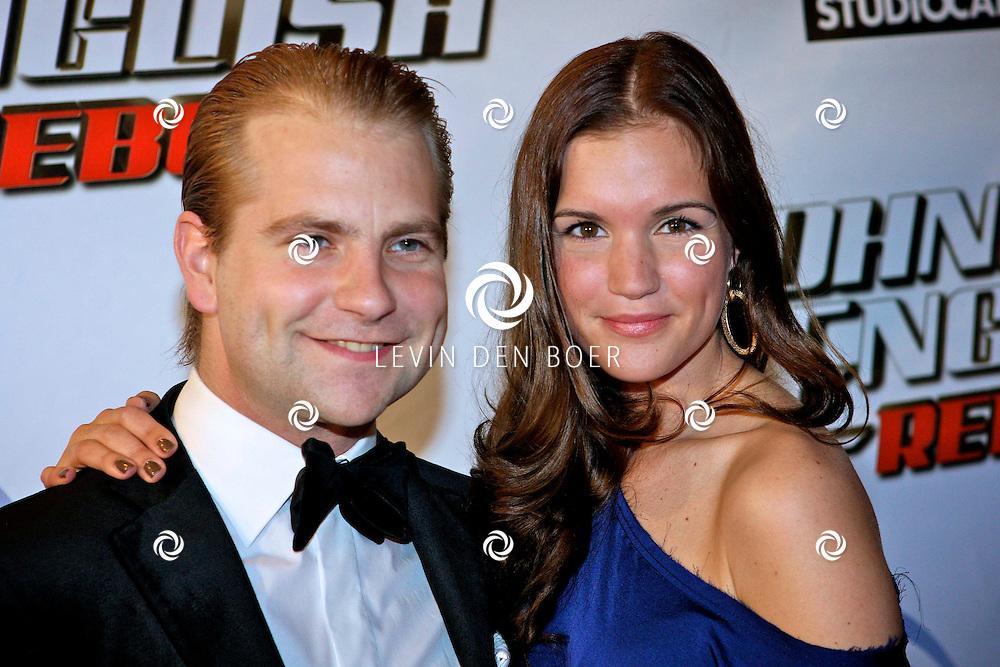 AMSTERDAM - Bij pathe theater Tuschinski is de filmpremiere van Johnny English.  Met op de foto Marly van der Velden en haar vriend Mike Meijer. FOTO LEVIN DEN BOER - PERSFOTO.NU