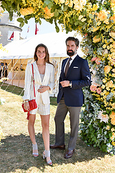 Catie Munnings and Jack Guinness at the 'Cartier Style et Luxe' enclosure during the Goodwood Festival of Speed, Goodwood House, West Sussex, England. 15 July 2018.