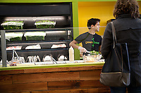 Employees make custom salads at Green Bean Salads in St. Louis, MO.