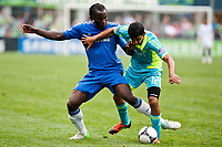 Seattle Sounders FC defender Leo Gonzalez puts pressure on Chelsea FC striker Romelu Lukaku during the 1st half of the match at CenturyLink Field.