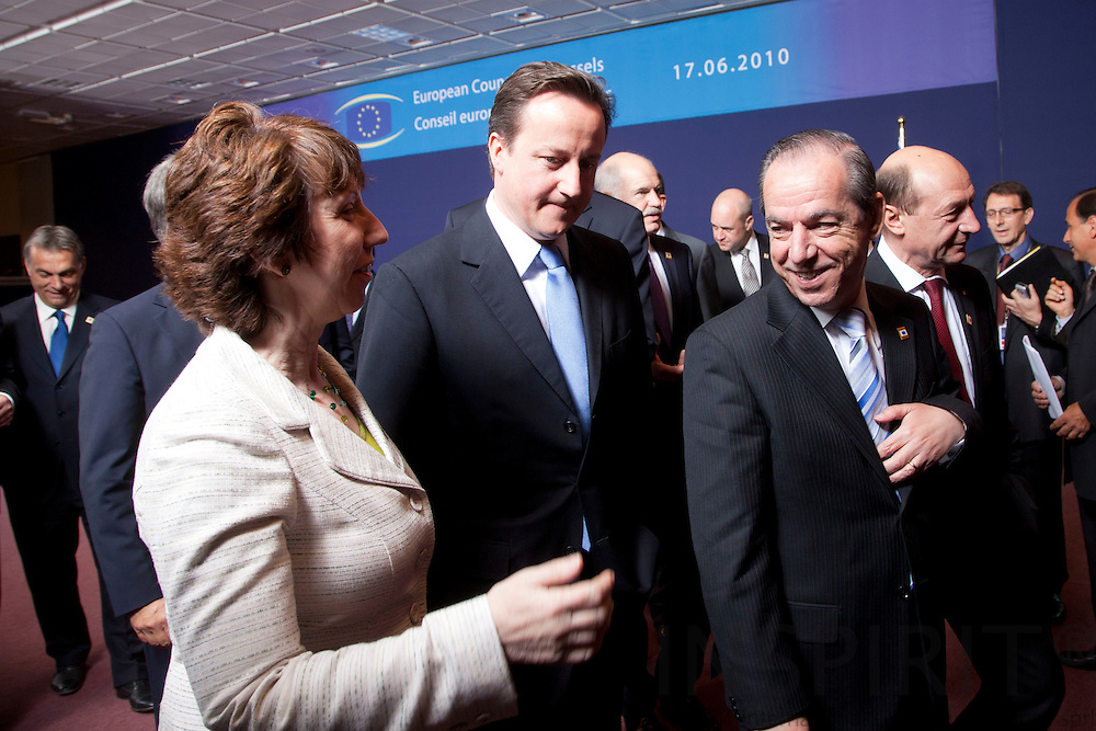 BRUSSELS - BELGIUM - 17 JUNE 2010 -- EU-Summit -- From left leaving the family photo is High Representative for Foreign Affairs and Security Policy Catherine Ashton, David Cameron, Prime Minister United Kingdom, and  Lawrence Gonzi, Prime Minister for Malta. PHOTO: ERIK LUNTANG / INSPIRIT Photo