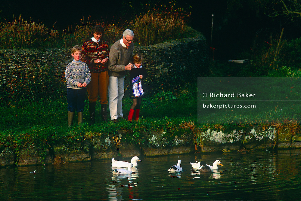 Douglas Hurd MP feeds ducks with his family near the family home in the summer of 1990 near Oxford. Douglas Richard Hurd, Baron Hurd of Westwell, CH, CBE, PC (b1930) is a British Conservative politician who served in the governments of Margaret Thatcher and John Major from 1979 to 1995.