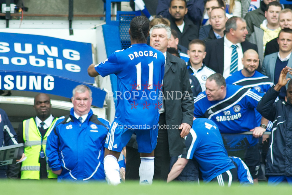 LONDON, ENGLAND - Sunday, May 9, 2010: Chelsea's Didier Drogba celebrates with Manager Carlo Ancelotti after scoring his 2nd goal from the penalty spot to make it 5-0 against Wigan Athletic during the final Premiership match of the season at Stamford Bridge. (Pic by Gareth Davies/Propaganda)