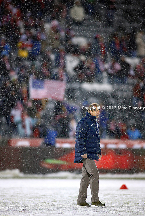 SHOT 3/22/13 6:40:41 PM - United State's men's soccer team head coach Jurgen Klinsmann during pre-game warmups before the team's game against Costa Rica in their World Cup qualifying game at Dick's Sporting Goods Park in Commerce City, Co. on Friday March 22, 2013. The U.S. won the game 1-0 in a spring blizzard that blanketed the pitch and stadium in snow. (Photo by Marc Piscotty / © 2013).