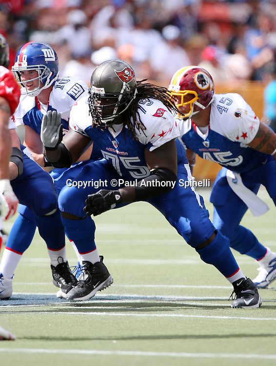 HONOLULU, HI - FEBRUARY 08: NFC All-Stars guard Davin Joseph #75 of the Tampa Bay Buccaneers blocks against the AFC All-Stars in the 2009 NFL Pro Bowl at Aloha Stadium on February 8, 2009 in Honolulu, Hawaii. The NFC defeated the AFC 30-21. ©Paul Anthony Spinelli *** Local Caption *** Davin Joseph