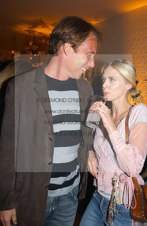 DAMIAN ASPINALL and DONNA AIRat a party to celebrate the opeing of the new Paul &amp; Joe Boutique at 134 Sloane Street, London SW1 on 14th April 2005.<br />
