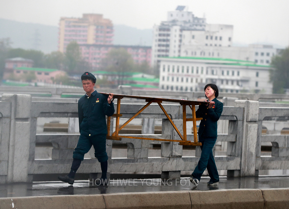 North Korean youths in uniform carries furniture along a bridge in Pyongyang, North Korea, 17 April 2017. A North Korean missile exploded within seconds of its launch on the east coast on 16 April, South Korean and US officials say as tensions rise in the region over nuclear issues.