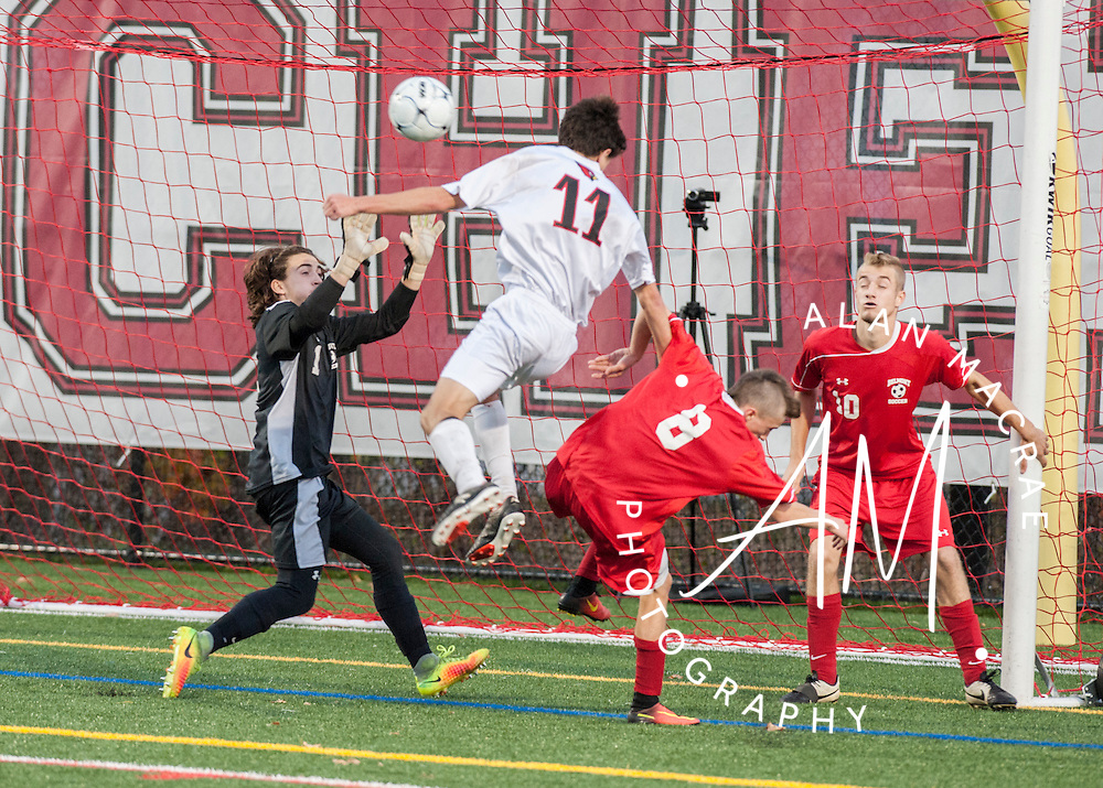 Stevens Drew Grenier heads the ball past Belmont's Jonny LeClair for the game winning goal in the NHIAA Division III semi-final game at Laconia High School on Wednesday, November 2, 2016.  (Alan MacRae/for the Laconia Daily Sun)