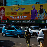 Advertising billboards with women wearing headscarf. Its a compulsory for advertising in the state of Kelantan.