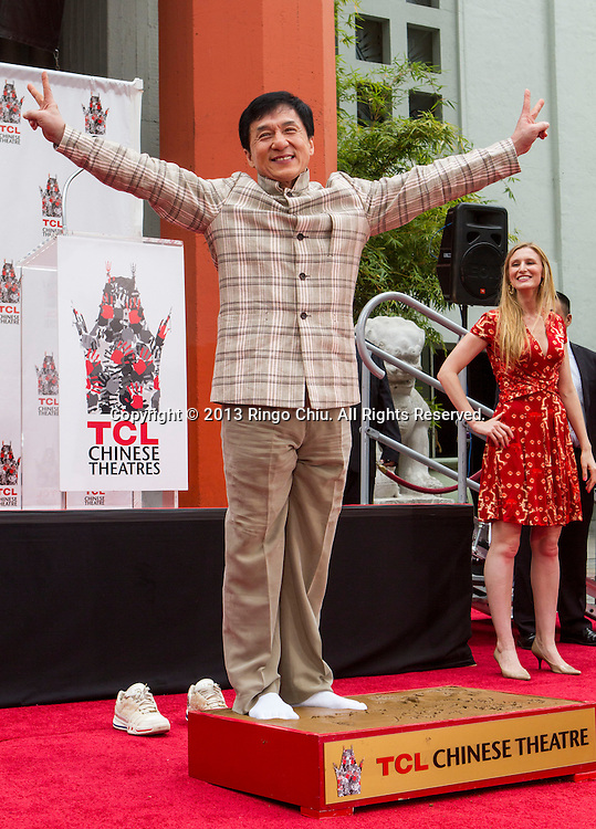 Actor Jackie Chan poses at his hand and footprint ceremony in front of the TLC Chinese Theatre in Hollywood, California on June 6,2013. Chan became the first ever Chinese star immortalized in cement in Hollywood. (Photo by Ringo Chiu/PHOTOFORMULA.com)