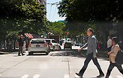2017 JULY 25 - Pedestrians cross 2nd Avenue at Cherry Street in downtown Seattle, WA, USA. By Richard Walker