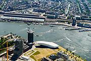 Nederland, Noord-Holland, Amsterdam, 29-06-2018; ZIcht op Oude Houthaven met Haparandadam en het gebouw Pontsteiger. Druk scheepvaartverkeer op het IJ. Onder in beeld KNSM werf.<br /> Busy shipping traffic on the IJ.<br /> <br /> luchtfoto (toeslag op standard tarieven);<br /> aerial photo (additional fee required);<br /> copyright foto/photo Siebe Swart