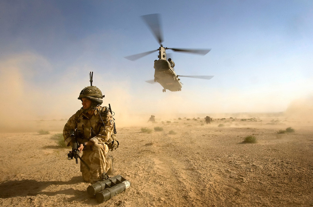 A British soldier of 3rd Battalion The Parachute Regiment secures a landing site as a Chinook Ch-47 helicopter takes off during an airborne assault as part of Operation 'Southern Beast'. Kandahar Province, Afghanistan on the 3rd of August 2008.