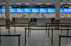 © Licensed to London News Pictures. 02/10/2017. Crawley, UK. Unattended Monarch Airlines check-in desks at Gatwick Airport after the airline ceased trading at midnight last night. The government has announced that it will start the country's biggest ever peacetime repatriation to fly about 110,000 stranded passengers home. Photo credit: Peter Macdiarmid/LNP