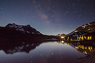 Milky Way stars and night sky over Ellery Lake, near Tioga Pass, just outside Yosemite National Park, California