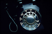 A black rotary telephone