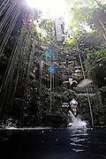 Sinkhole cliff diving competition held in Mexico<br /> <br /> Daredevil athletes have jumped from the edge of a 90ft deep sinkhole in a remote part of Mexico, as part of a cliff diving contest.<br /> Divers in the 'Cliff Diving World Series' performed stunts and reached speeds of 40mph before hitting the dark water of Cenote Ik Kil.<br /> Gary Hunt, from Southampton was the overall winner and managed to pull off a Triple Quad – one of the most difficult dives in the world.<br /> The Red Bull event lasted for two days -- though most of that time was probably taken up trying to get back out after each jump. <br /> Gary scored 373.85 and edged out second-placed Silchenko by a little over 10 points, with 2009 champion Duque taking third place.<br /> <br /> Photo Shows: Alain Kohl of Luxembourg dives from the 27.2 metre platform during training in the lead up to round two of the 2010 Red Bull Cliff Diving World Series, Cenote Ik Kil, Yucatan, Mexico on June 05; 2010. <br /> (©Ray Demski/Exclusivepix)
