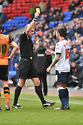 Bolton Wanderers Midfielder, Mark Davies shown a yellow card, booked during the Sky Bet Championship match between Bolton Wanderers and Hull City at the Macron Stadium, Bolton, England on 30 April 2016. Photo by Mark Pollitt.