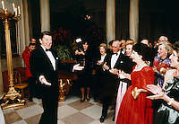 07 Feb 1981, United States --- Ronald Reagan looks dashing to of a group of admiring women, just before blowing out his seventy birthday candles. --- Image by © Owen Franken/