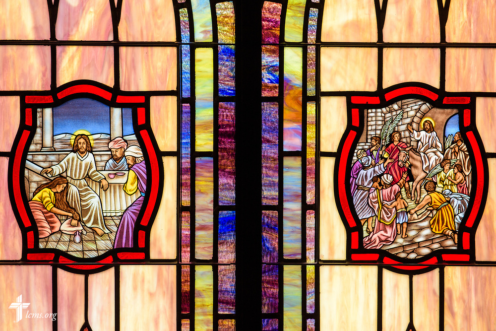 Stained glass depicting the woman washing the feet of Jesus (John 12) and the triumphal entry of Jesus Christ (Luke 19:28) at St. John's Lutheran Church, Conover, N.C, on Friday, April 21, 2017. LCMS Communications/Erik M. Lunsford
