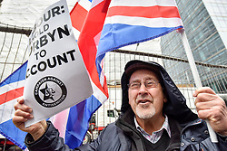 © Licensed to London News Pictures. 08/04/2018. LONDON, UK. A demonstrator shouts at a protest calling for Jeremy Corbyn, leader of the Labour party, to be held to account.  The event was organised by the Campaign Against Anti-Semitism, outside the Labour Party's headquarters in central London.  Photo credit: Stephen Chung/LNP