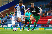 Blackburn Rovers Ben Marshall and Bristol City defender, Aden Flint (4) battle during the Sky Bet Championship match between Blackburn Rovers and Bristol City at Ewood Park, Blackburn, England on 23 April 2016. Photo by Pete Burns.