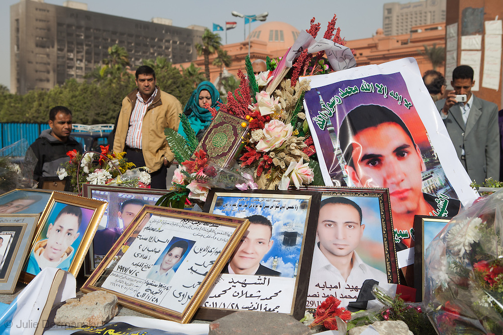 People at a makeshift memorial for the martyrs of the Egyptian revolution in Tahrir Square in front of the Egyptian Museum in Cairo three day after Mubarak stepped down.  MIllions took to the streets in Egypt and overthrew Mubarak's regime in a revolution that started on January 25th that toppled the regime in 18 days.