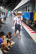 17 APRIL 2013 - BANGKOK, THAILAND:   A man gets off a train in Hua Lamphong Train Station in Bangkok. Songkran, the traditional Thai New Year, is the busiest time of the year for Thai domestic travel. Many people in Bangkok return to their home provinces for the holiday and some people in the provinces travel to Bangkok for the holiday. Songkran, usually a three day holiday, was five days this year because the official days on the weekend. Trains and buses coming into Bangkok were reported to be fully booked and the State Railway of Thailand added extra trains and carriages to accommodate the crowds.  PHOTO BY JACK KURTZ