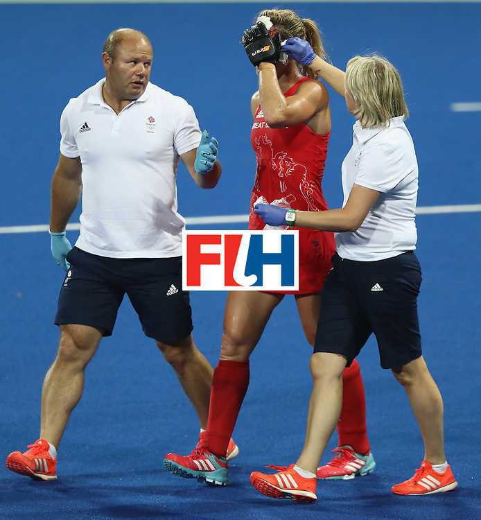 RIO DE JANEIRO, BRAZIL - AUGUST 17:  Crista Cullen of Great Britain receives attention after being hit in face during the Women's hockey semi final match betwen New Zealand and Great Britain on Day12 of the Rio 2016 Olympic Games at the Olympic Hockey Centre on August 17, 2016 in Rio de Janeiro, Brazil.  (Photo by David Rogers/Getty Images)